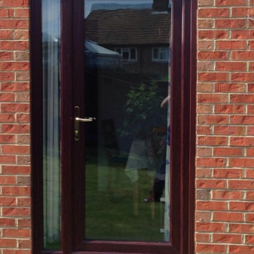 Rosewood timber door in Blyth + glass side panel