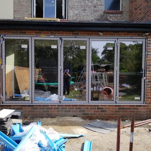 Large WarmCore Aluminium Bi-fold Patio Door in Forest Hall